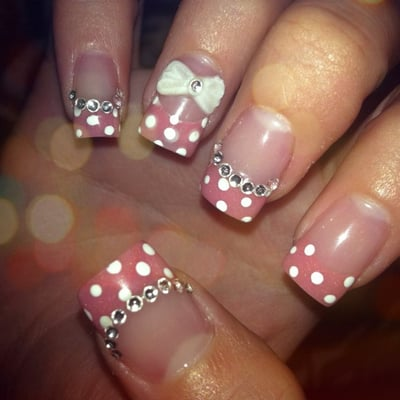 Acrylic nails. Clear base w/ glitter pink white polka dot tips