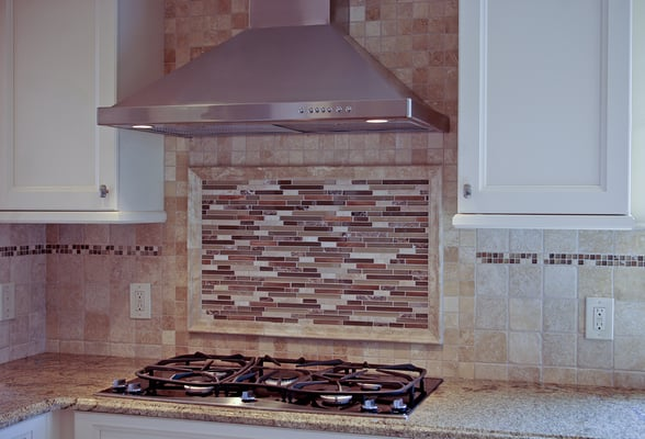 Tumbled marble and framed glass backsplash in half moon for Tumbled glass tile