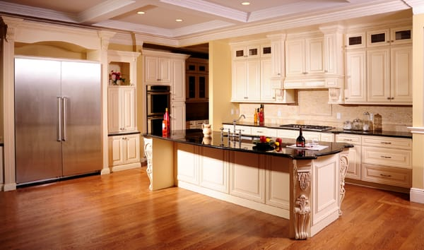 Antique Cream Kitchen Cabinets with Absolute Black Countertops | Yelp