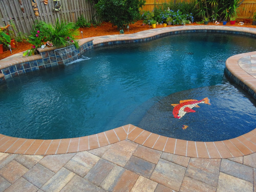Freeform pool with black pebble finish and red fish mosiac for Pool design jacksonville fl