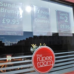 Storefront advertising The Rupee Room meal deals.