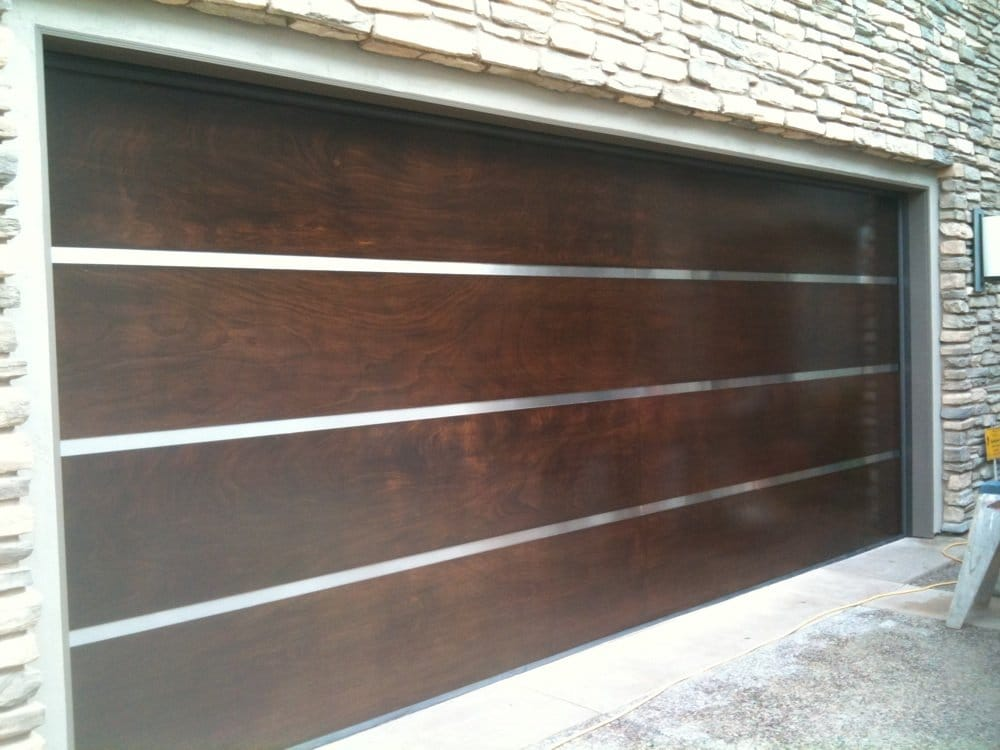 Mahogany wood door with stainless steel strip yelp for 12x12 roll up garage door