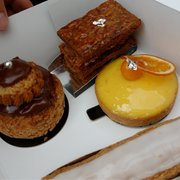 A chocolate religieuse, a mille-feuille and an orange tart. All of them exquisite !