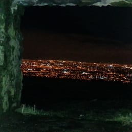 The lights of Dublin city framed by a window of The Hellfire club