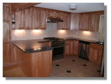 red birch cabinets, granite tops, tiled back splash and tile floor ...