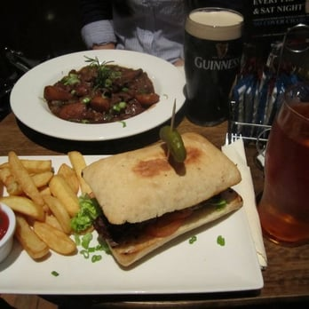Guinness beef stew (far) and steak sandwich (close)