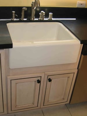 Kitchen remodel with apron sink, pre-fab granite countertop. Yelp