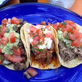 Three different kinds of Tacos (from left to right: carne asada, pollo asado, carnitas)