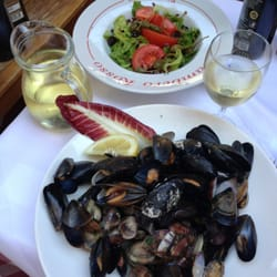 Mussels and clams in marinara sauce,…