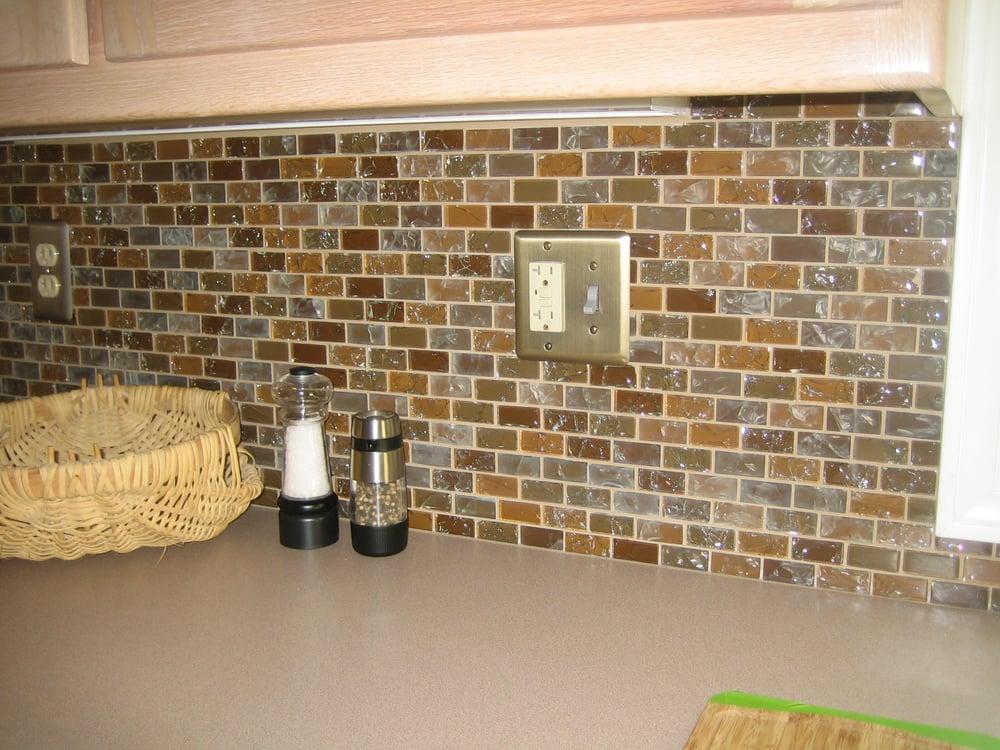 kitchen remodel with glass tile back splash platinum