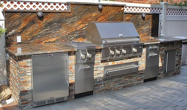 Viking outdoor kitchen with stone veneer installed in for Viking outdoor kitchen