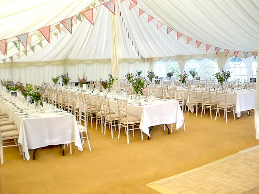 Marquee wedding with vintage accessories and bunting strung across