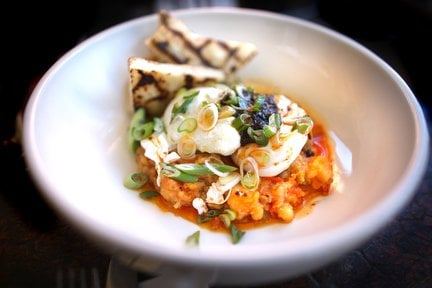 Salt cod hash with poached eggs, harissa, scallions and grilled flat ...