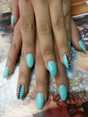 Stiletto nails / almond shaped nails with Gel color #71 with a cute ...