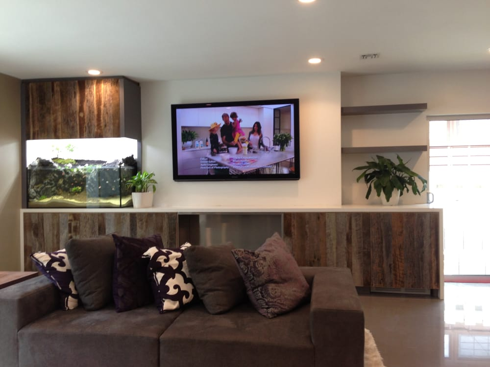 Modern family room custom entertainment cabinet built in for Fish tank fireplace