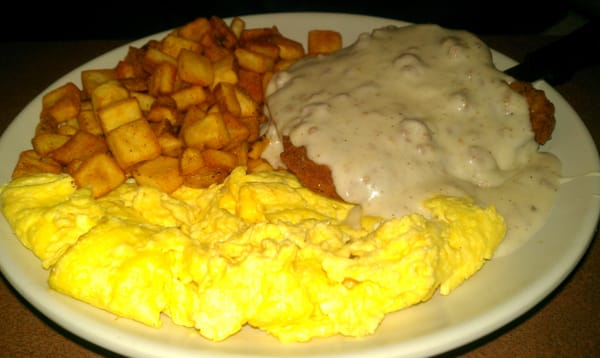 Chicken Fried Steak, scrambled eggs with gravy and seasoned potatoes