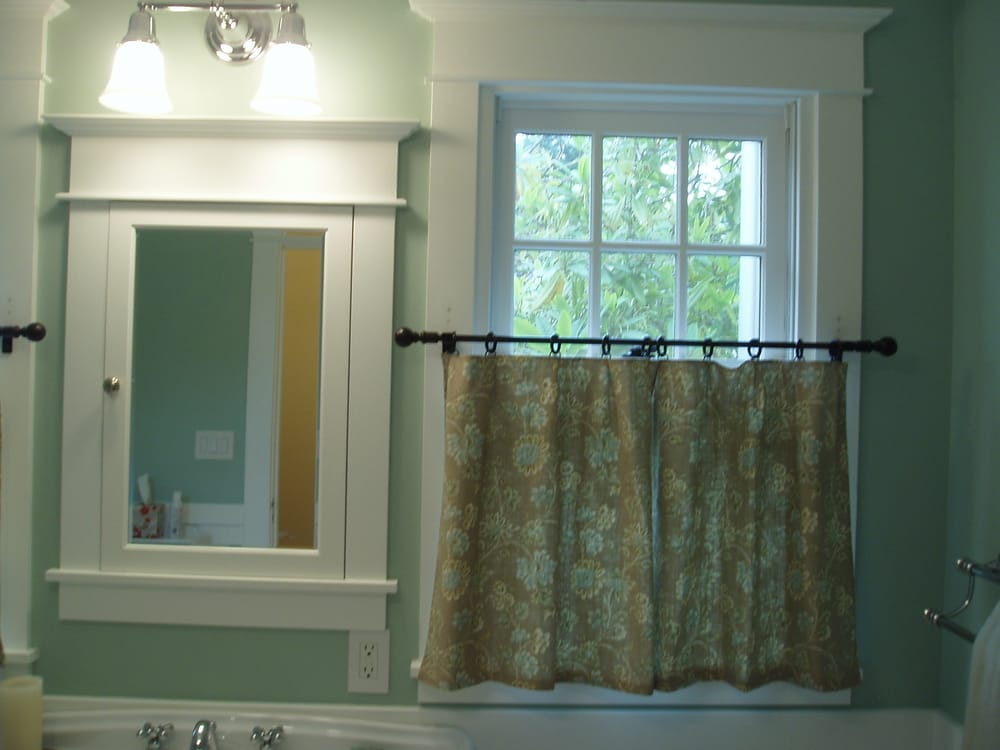 Custom sewn cafe curtains add the perfect touch to this modern farm