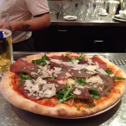Pizza delizia. €9.50.  Some sort of arugula and beef ham.  Delicious!  And an Augustiner.