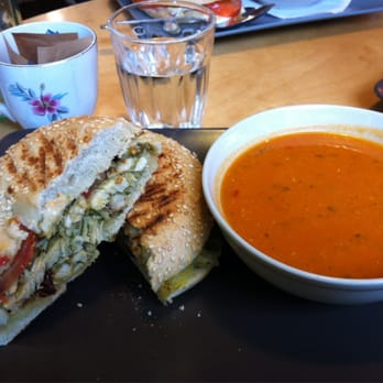 Pesto chicken and sun dried tomatoes on a bagel plus zesty tomato soup.
