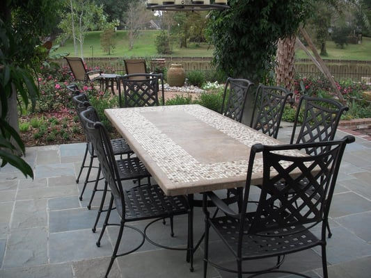 Stone top dining table with outdoor chairs from Bay Breeze Patio