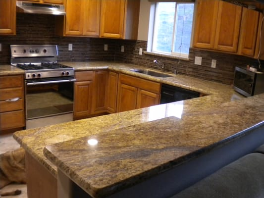 Golden ridge granite w glass backsplash yelp for Granite countertop overhang support requirements