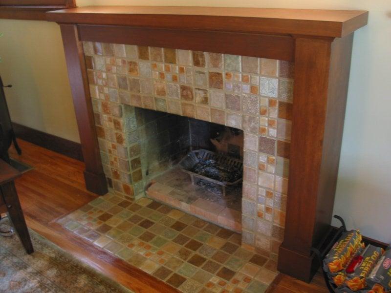 uncovered vintage tile fireplace beneath false brick