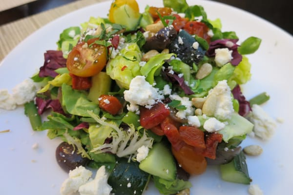 Chopped vegetable salad with feta cheese, garlic croutons, creamy ...