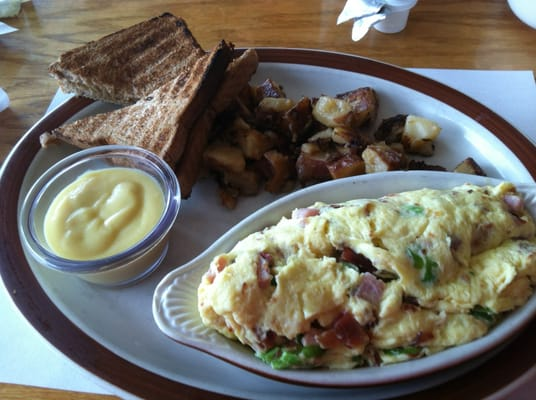 yelp.comCombo Scramble (eggs with bacon, ham, cream cheese, chives and