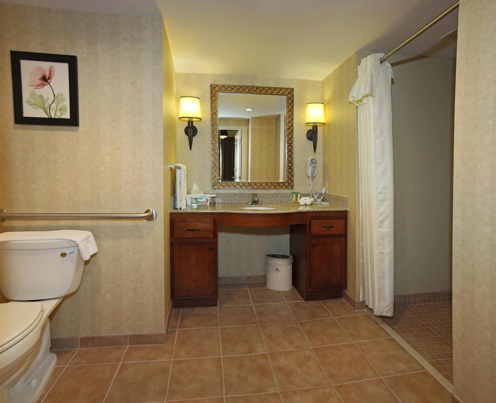 Handicap accessible bathroom only in selected suites yelp for Pictures of handicap bathrooms