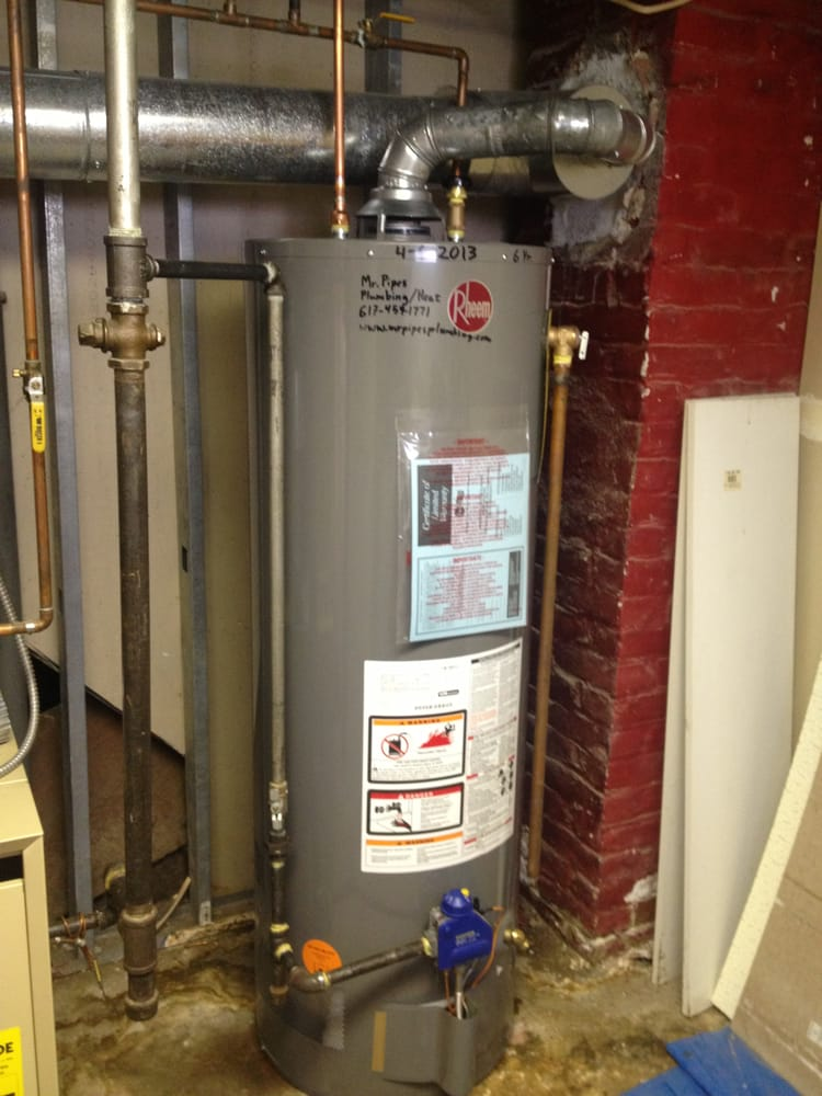 Rheem natural gas hot water heater installed for a for Water heater pipe