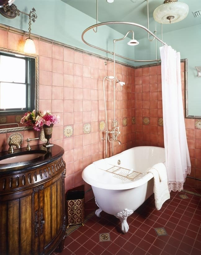 This Bathroom Features An Antique Clawfoot Bathtub With A
