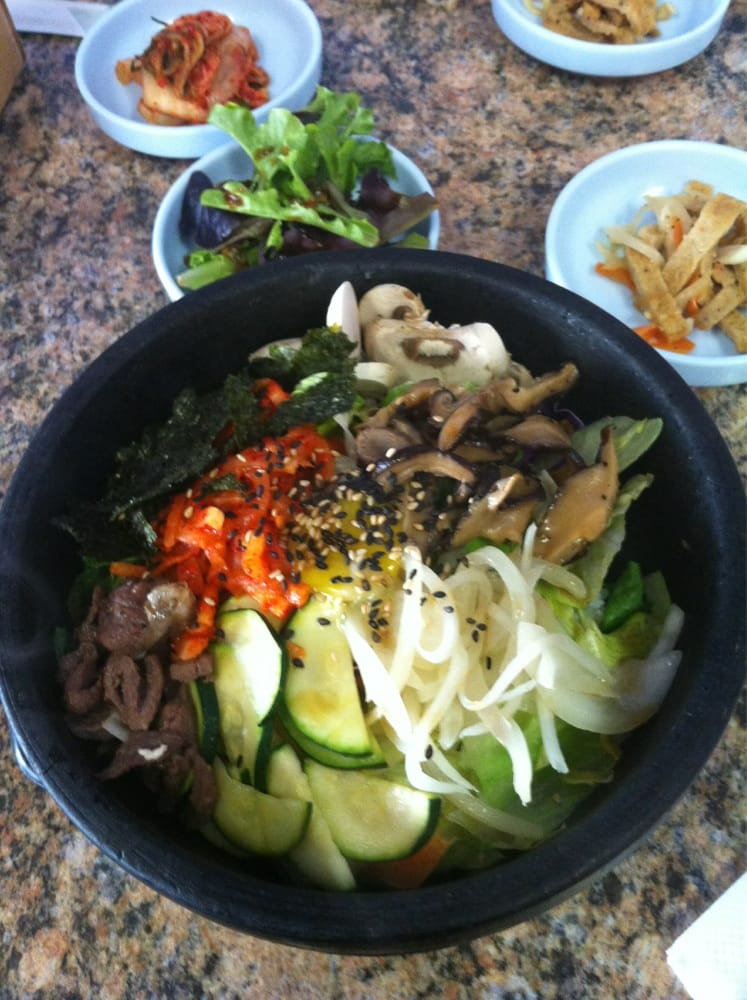 Bi bim bap in a hot stone pot and side dishes salad for What sides go with fish