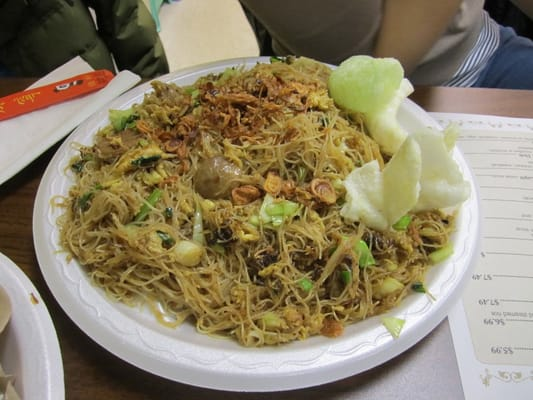... stir fried rice noodles with chicken, meatballs, egg, and vegetables