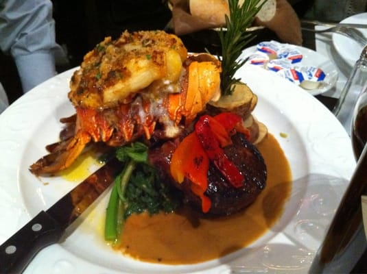 Under cooked lobster tail with Filet Mignon (hockey puck)