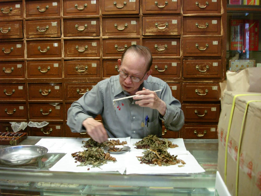 Herbalist preparing traditional chinese medicine according