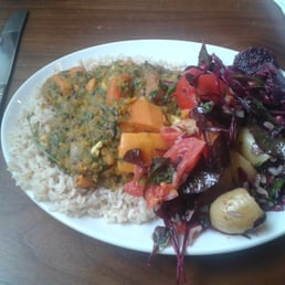 Sweet potato, tofu, spinach and lentil curry with brown rice and 2 side salads. Massive portion of goodness!