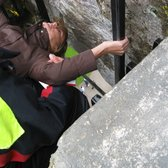 About to kiss the Blarney Stone and holding on tight!