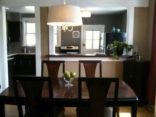 created opening breakfast bar between kitchen and dining room new