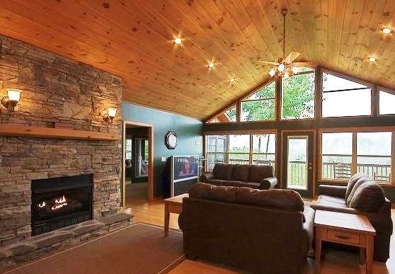 Great room with cathedral ceiling wall of windows for Vaulted ceiling great room
