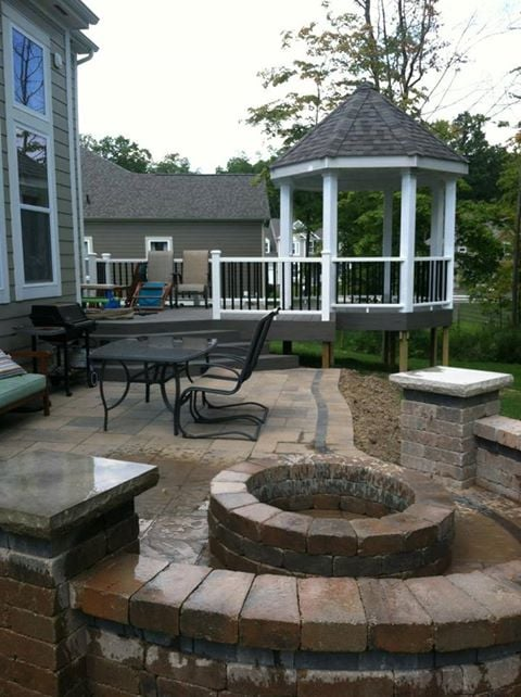Features gazebo, firepit, paver patio with seating wall and a deck