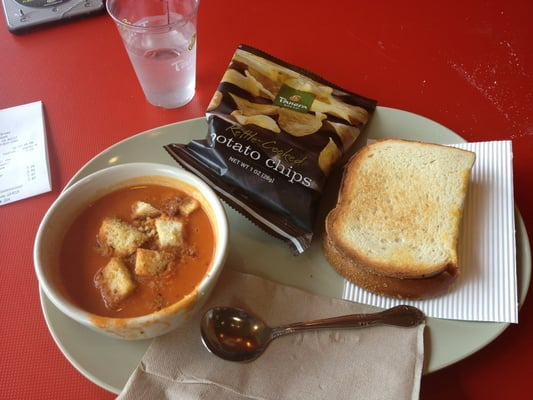 Creamy tomato soup with the classic grilled cheese + chips | Yelp