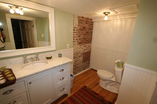Bathroom Renovation With Custom Cabinets And Exposed Brick Wall Yelp