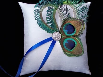 Custom peacock wedding accessories like this fabulous peacock ring pillow at