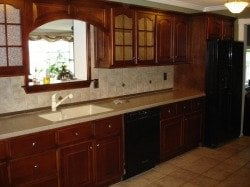 Oak cabinets after being refinished with a cherry stain... | Yelp