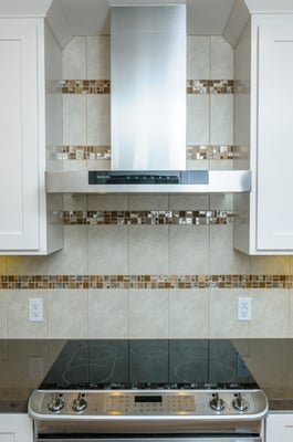kitchen backsplash featuring porcelain tile accented with