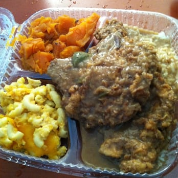 Smothered pork chops over rice, candy yams and Mac&cheese delicious!