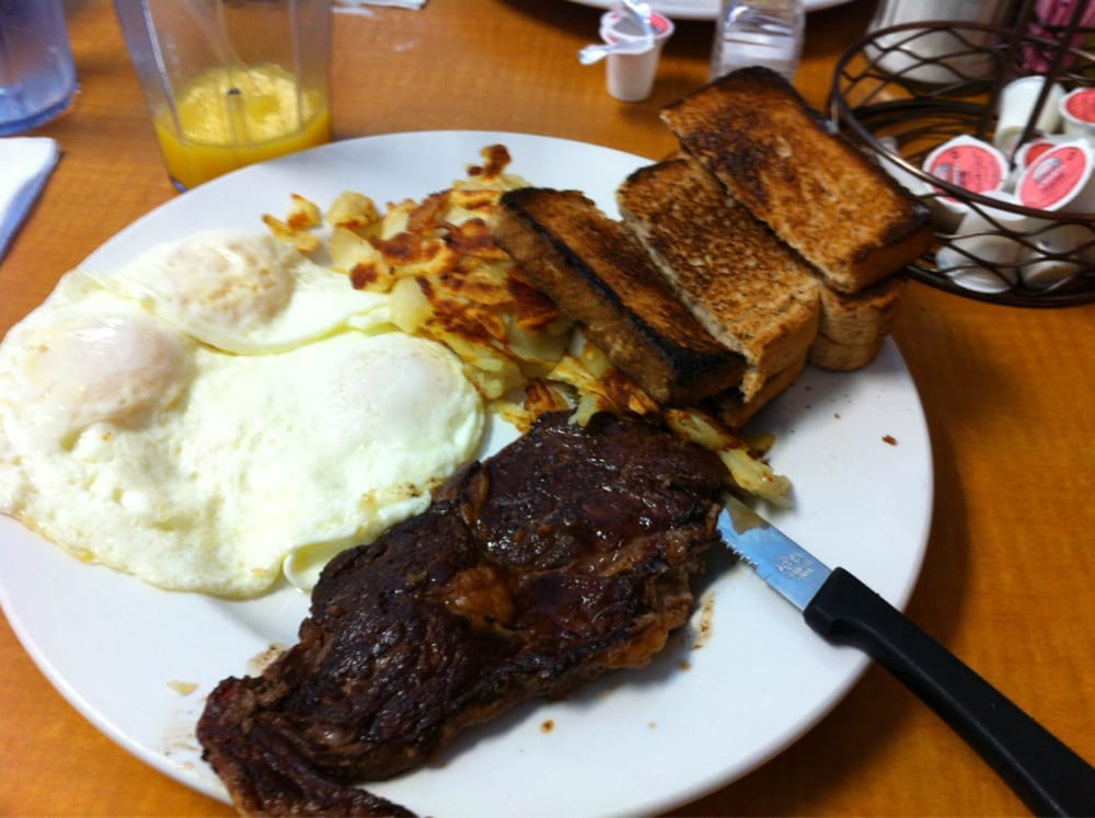 oz Ribeye steak with three eggs, hash browns, and wheat bread ...