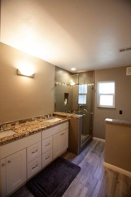Star Beach granite tops - White shaker cabinets - 12 x 24 wall