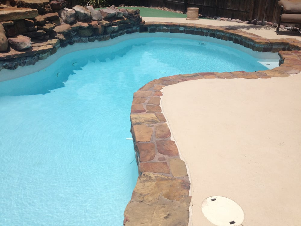 Flagstone Pool Coping Surrounding Salt Water Swimming Pool Treated With Dupont Stone Sealer In