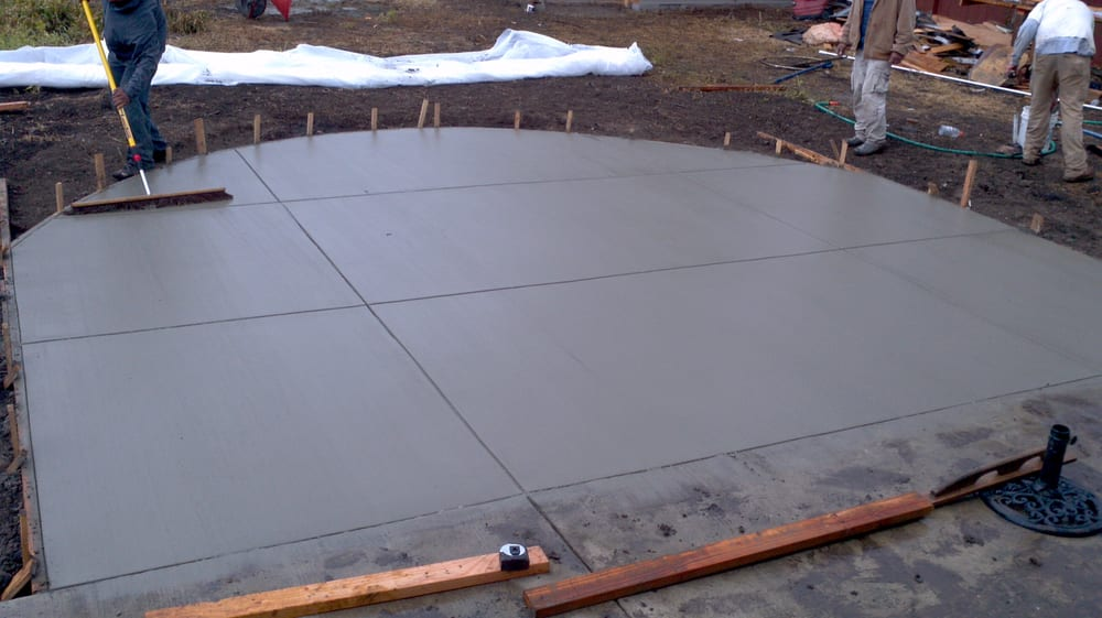 picture of a freshly poured concrete patio we do concrete